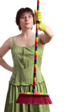 Woman holding a broom Stock Images