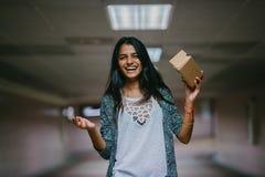 Woman Holding Brown Cardboard Box stock photos