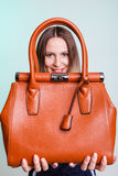 Woman holding brown leather handbag. Royalty Free Stock Image