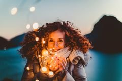Woman Holding Brown Light during Nighttime royalty free stock photography