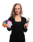 Woman Holding Brush and Color Swatches. Isolated over white background Stock Photos