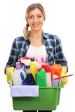 Woman holding bucket with cleaning products Stock Images