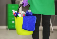 Woman holding bucket with cleaning products stock photos