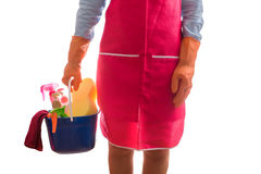 Woman holding a bucket full of cleaning supplies isolated on whi Stock Photo