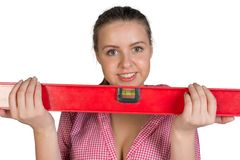 Woman holding builders level Royalty Free Stock Photos