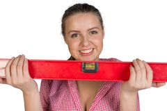 Woman holding builders level Royalty Free Stock Image
