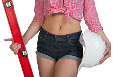 Woman holding builders level and hard hat Stock Image
