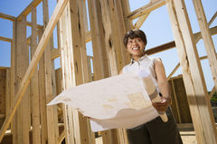 Woman Holding Building Plans Royalty Free Stock Images