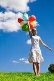 Woman holding bunch of balloons Royalty Free Stock Photo