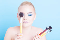 Woman holding bunch of brushes as make-up concept Royalty Free Stock Image