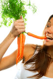 Woman holding bunch of carrots Royalty Free Stock Photography