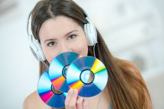 Woman holding bunch cds. Woman holding a bunch of cds royalty free stock photography