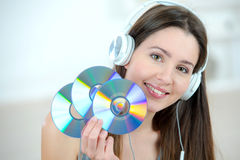 Woman holding bunch cds Royalty Free Stock Photos