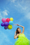 Woman holding bunch of colorful air balloons Stock Images