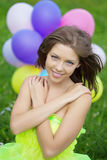 Woman holding bunch of colorful air balloons Stock Photo