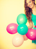 Woman holding bunch of colorful balloons Stock Photos