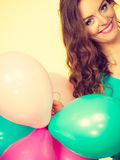 Woman holding bunch of colorful balloons Stock Images