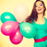 Woman holding bunch of colorful balloons Royalty Free Stock Photography