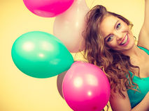 Woman holding bunch of colorful balloons Stock Image