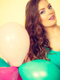 Woman holding bunch of colorful balloons Royalty Free Stock Photos