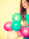 Woman holding bunch of colorful balloons Royalty Free Stock Image