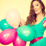 Woman holding bunch of colorful balloons Stock Photography