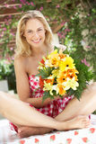 Woman Holding Bunch Of Flowers Stock Photo