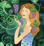 Woman holding bunch of grapes Stock Image