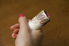 Woman holding a bunch of Israeli New Sheqel banknotes Royalty Free Stock Photo