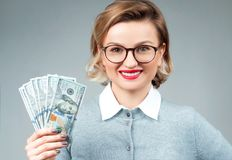 Woman holding bunch of money banknotes. Bundle of bills of one hundred dollars in female hands Royalty Free Stock Photos