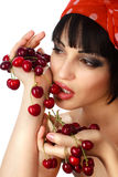 Woman holding a bunch of red cherries Stock Image