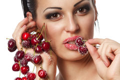 Woman holding a bunch of red cherries Stock Images