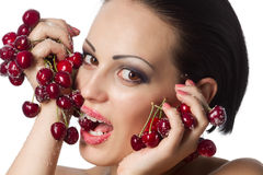 Woman holding a bunch of red cherries Royalty Free Stock Photo