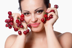 Woman holding a bunch of red cherries Royalty Free Stock Images