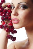 Woman holding a bunch of red cherries Royalty Free Stock Photos
