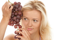 Woman holding bunch of red grapes Royalty Free Stock Image