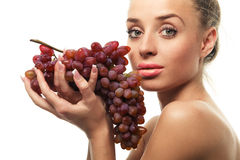 Woman holding a bunch of red grapes Royalty Free Stock Image