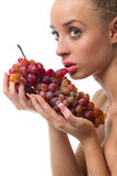 Woman holding a bunch of red grapes Stock Photo