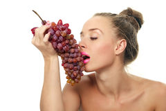 Woman holding a bunch of red grapes Royalty Free Stock Photos