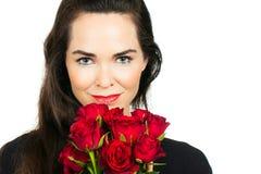 Woman holding bunch of roses. Beautiful woman holding and smelling a bunch of roses. Isolated on white stock photos