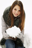 Woman holding a bunch of snow Stock Photo