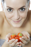 Woman holding a bunch of strawberries Royalty Free Stock Photos
