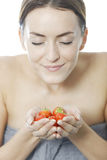 Woman holding a bunch of strawberries Stock Photo