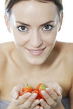 Woman holding a bunch of strawberries Royalty Free Stock Photo