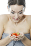 Woman holding a bunch of strawberries Stock Photography