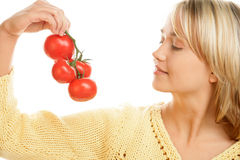 Woman holding bunch of tomatoes Royalty Free Stock Photography