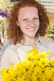 Woman holding a bunch of yellow flowers Stock Photography