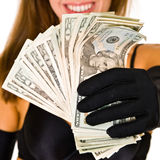 Woman holding a bundle of money Stock Image