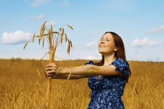 Woman holding bundle of wheat ears Royalty Free Stock Photos