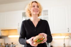 Woman holding burger royalty free stock image
